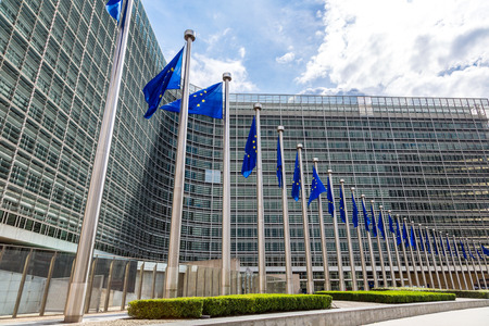 central european: European flags in front of  headquarters of European commission in Brussels in summer day