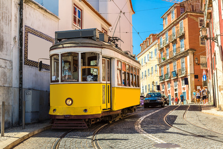 electric tram: Vintage tram in the city center of Lisbon in a summer day, Portugal