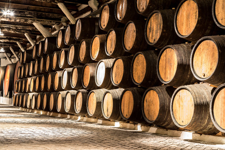 wine barrel: Barrels in the wine cellar in Porto in Portugal