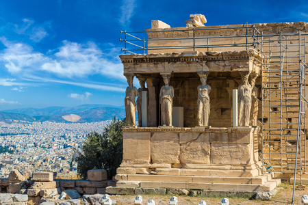 caryatids: Caryatids, Erechtheum temple ruins on the Acropolis in a summer day in Athens, Greece