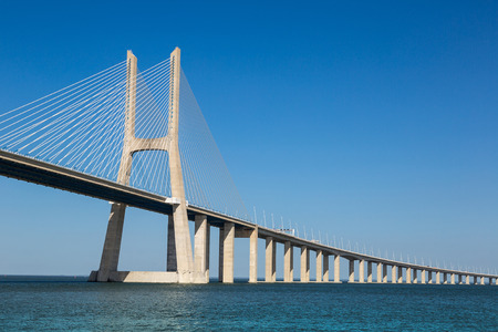 city landscape: The Vasco da Gama Bridge in Lisbon, Portugal in a summer day