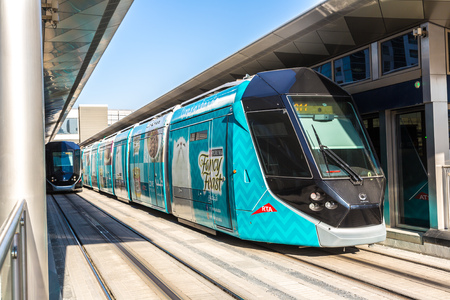 rta: DUBAI, UAE - DECEMBER 5: New modern tram in Dubai, UAE. December 5, 2015 in Dubai, United Arab Emirates