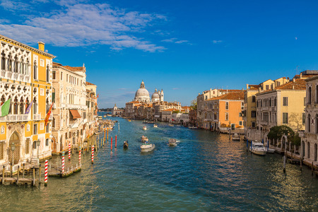 venice canal: Basilica Santa Maria della Salute and Grand Canal in Venice in a beautiful summer day in Italy Stock Photo