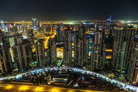 night dusk: Aerial view of downtown Dubai in a summer day, United Arab Emirates