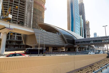 rta: Futuristic metro station in Dubai in a summer day