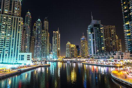 urban scene: Dubai marina in a summer night, Dubai, UAE.
