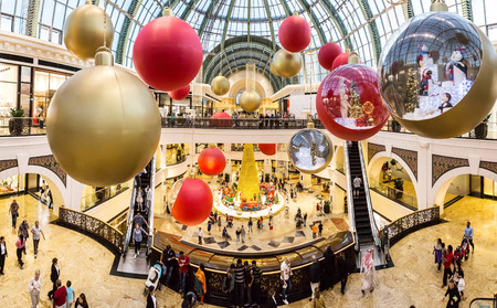 mall of the emirates: DUBAI, UAE - DECEMBER 31: Shoppers at Mall of the Emirates decorated for christmas holiday  in Dubai on December 31, 2015