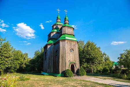 pirogovo: Traditional ukrainian church in the museum of national architecture in Pirogovo in a summer day, Kiev, Ukraine Editorial