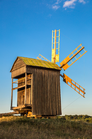 pirogovo: Traditional ukrainian windmill in the museum of national architecture in Pirogovo in a summer day, Kiev, Ukraine Editorial