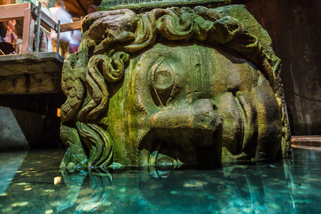 cistern: ISTANBUL - AUGUST 8, 2015: Medusa head in the Basilica Cistern.