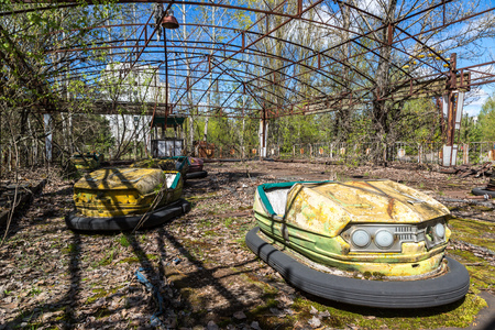chernobyl: Abandoned amusement park in Pripyat, Chernobyl region, Ukraine in a summer day