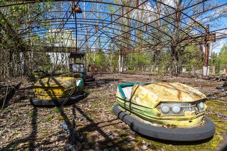 Abandoned amusement park in Pripyat, Chernobyl region, Ukraine in a summer day