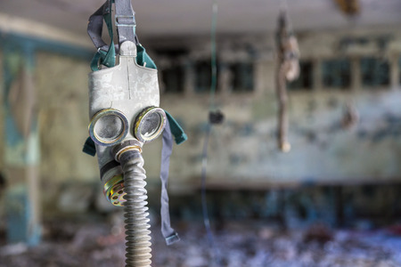 pripyat: Gas masks in the middle school in Pripyat, Chernobyl region, Ukraine in a summer day Stock Photo