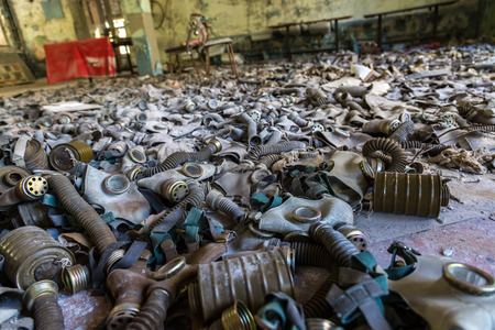 chernobyl: Gas masks on the floor in the middle school in Pripyat, Chernobyl region, Ukraine in a summer day Stock Photo