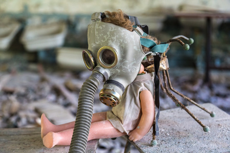 Creepy doll in middle school in Pripyat, Chernobyl region, Ukraine in a summer day