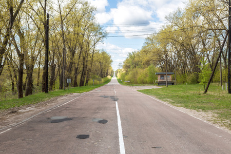 chernobyl: The road from Chernobyl city, Ukraine in a summer day