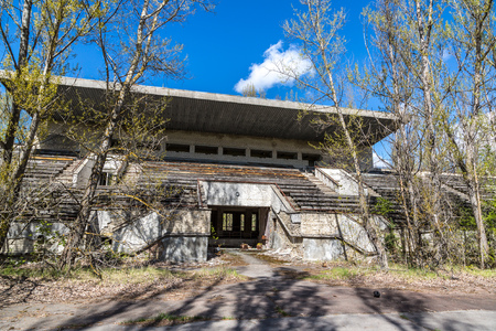chernobyl: Abandoned stadium in Pripyat, Chernobyl region, Ukraine in a summer day Stock Photo