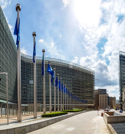 institutional: European flags in front of  headquarters of European commission in Brussels in summer day