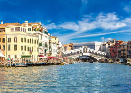 Gondola at the Rialto bridge in Venice, in a beautiful summer day in Italy Stock Photo