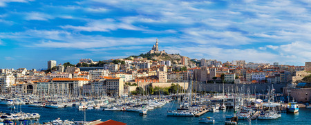 Aerial panoramic view on basilica of Notre Dame de la Garde and old port  in Marseille, France 写真素材