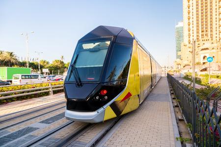 DUBAI, UAE - DECEMBER 5: New modern tram in Dubai, UAE. December 5, 2015 in Dubai, United Arab Emirates