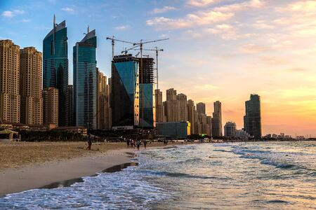 retail scene: Dubai marina in the summer evening, sunset, United Arab Emirates
