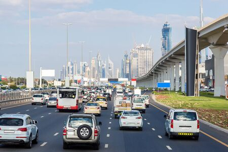 city traffic: Traffic jam at Sheikh Zayed Road in Dubai in a summer day, United Arab Emirates Stock Photo