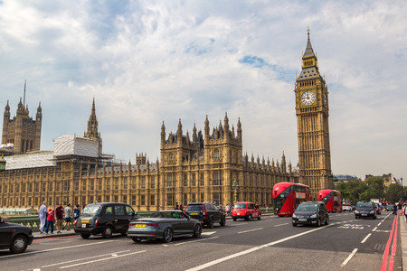 british touring car: LONDON, UNITED KINGDOM - JUNE 14, 2016: Big Ben, Westminster Bridge and red double decker bus in London, England, United Kingdom on June 14, 2016