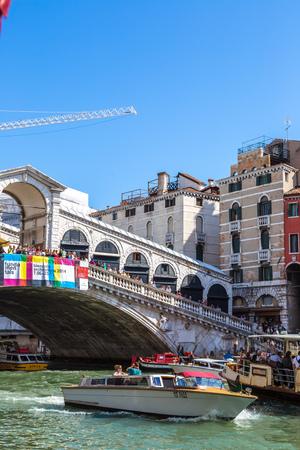 VENICE, ITALY - JUNE 18, 2014: Gondola at the Rialto bridge in Venice, in a beautiful summer day in Italy on June 18