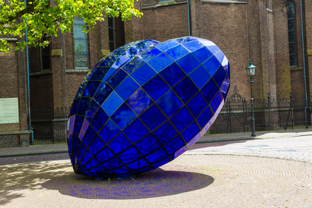DELFT, THE NETHERLANDS - JUNE 16, 2016: Blue Heart sculpture in historical center of Delft in a beautiful summer day, The Netherlands on June 16, 2016