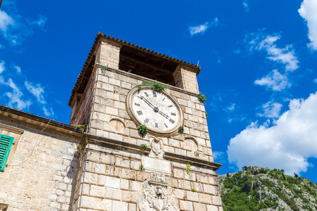Medieval clock tower in Kotor in a beautiful summer day, Montenegro Stock Photo