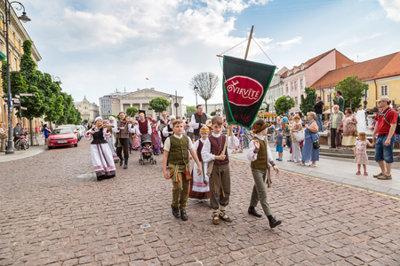 street musician: VILNIUS, LITHUANIA- JUNE 12, 2016: Unidentified peoples in traditional parade in Vilnius in a beautiful summer day, Lithuania on June 12, 2016