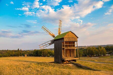 Traditional ukrainian windmill  in Pirogovo in a beautiful summer day, Kiev, Ukraine