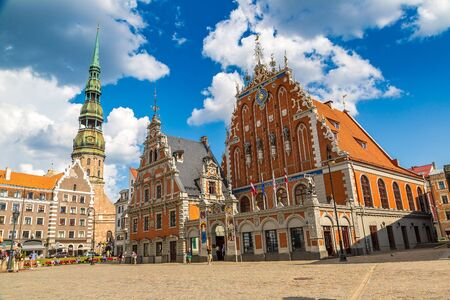 House of the Blackheads and Saint Peters church in Riga in a beautiful summer day, Latvia Stock Photo