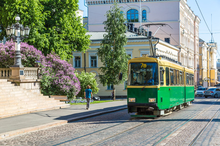 Public transport, retro tram in Helsinki in a beautiful summer day, Finland