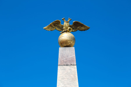Double-headed eagle on the Alexander column in Helsinki in a beautiful summer day, Finland