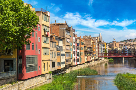 metalic: Colorful houses and Eiffel bridge in Girona, in a beautiful summer day, Catalonia, Spain
