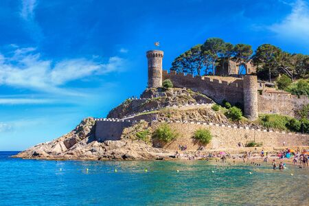 Beach at Tossa de Mar and fortress in a beautiful summer day, Costa Brava, Catalonia, Spain Editorial