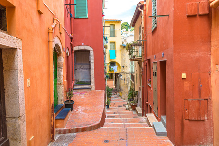 menton: Old narrow street in Menton on french Riviera in a beautiful summer day, France Stock Photo