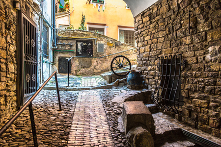 Medieval, old street in San Remo in a beautiful summer day, Italy