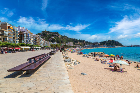 BLANES, SPAIN - JUNE 26, 2016: Tourists enjoy at the beach in Blanes in Costa Brava in a beautiful summer day, Spain on June 26, 2016 Editorial