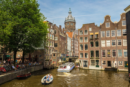 saint nicolas: AMSTERDAM, THE NETHERLANDS - JUNE 16, 2016: Canal and St. Nicolas Church in Amsterdam in a beautiful summer day, The Netherlands on June 16, 2016 Editorial