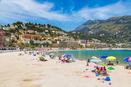 menton: MENTON, FRANCE - JUNE 13, 2016: Colorful old town and beach in Menton on french Riviera in a beautiful   summer day, France on June 13, 2016 Editorial