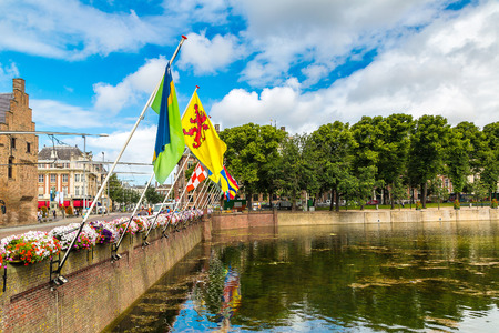 the hague: Lake Hofvijver with flags near Binnenhof palace in   Hague in a beautiful summer day, The Netherlands