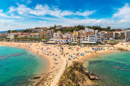 Tourists enjoy at the beach in Blanes in Costa Brava in a beautiful summer day, Spain Banco de Imagens