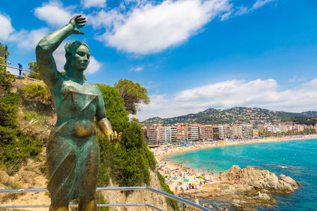 Dona Marinera monument to wifes sailor in Lloret de Mar in Costa Brava in a beautiful summer day, Spain