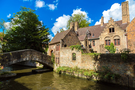 benelux: Houses along the canal in Bruges in a beautiful summer day, Belgium