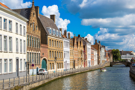 Houses along the canal in Bruges in a beautiful summer day, Belgium