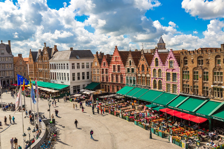 benelux: BRUGES, BELGIUM - JUNE 14, 2016: Panoramic view of Market Square in Bruges in a beautiful summer day, Belgium on June 14, 2016 Editorial