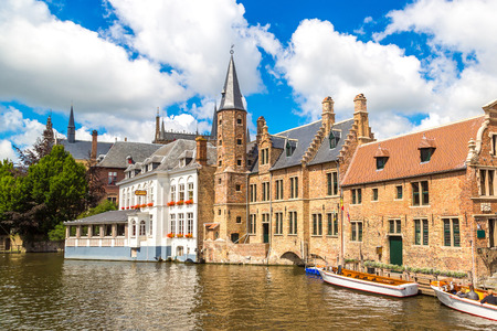 benelux: Tourist boat on canal in Bruges in a beautiful summer day, Belgium